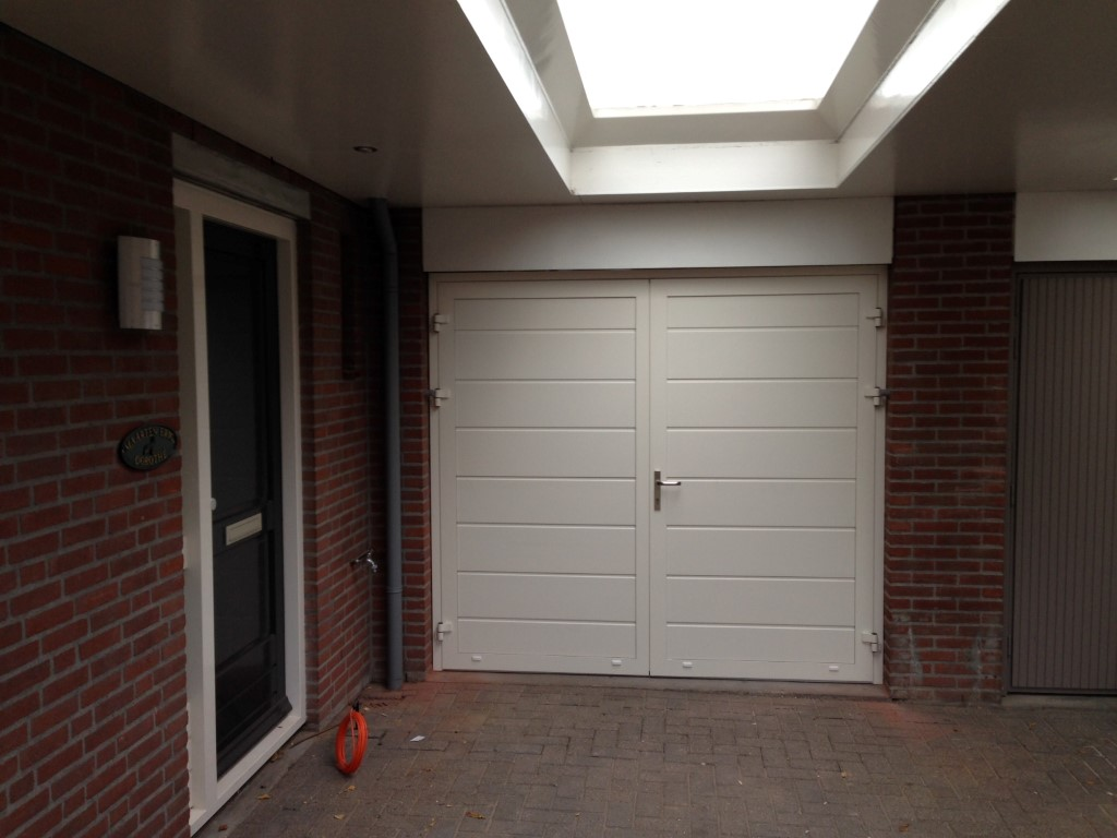 Openslaande Deuren Kosten : Kunststof garagedeuren uw specialist in bedrijfs en